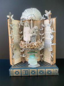 "Teresa Yatsko • <em>Communion</em> • Altered book, mixed media • 9""×12""×6"" • $225.00"