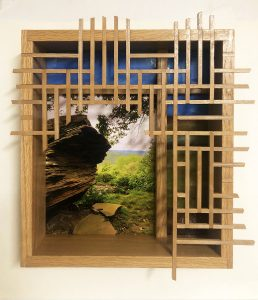 """Eva M. Capobianco • <em>FLT – Map 30, Boulder with Lattice</em> • Photo, stained glass and re-used wood • 15""""×17""""×3½"""" • $525.00<a class=""""purchase"""" href=""""https://state-of-the-art-gallery.square.site/product/eva-m-capobianco-flt-map-30-boulder-with-lattice/275"""" target=""""_blank"""">Buy</a>"""