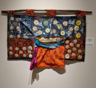 """Leanora E. Mims • <em>Say Her Name: Atatiana Jefferson, Bullet Proof Soul</em> • Mixed media quilted wall hanging • 23""""×19½"""" • $950.00<a class=""""purchase"""" href=""""https://state-of-the-art-gallery.square.site/product/leanora-e-mims-say-her-name-atiana-jefferson-bullet-proof-soul/383"""" target=""""_blank"""">Buy</a>"""
