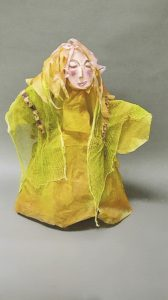 """MaryAnn Bowman • <em>Yellow Lady</em> • Paper print on foam core  • 8""""×10"""" • $35.00<a class=""""purchase"""" href=""""https://state-of-the-art-gallery.square.site/product/maryann-bowman-yellow-lady/559"""" target=""""_blank"""">Buy</a>"""