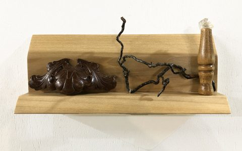 """Eva M. Capobianco • <em>Off the Wall</em> • Found wood • 10½""""×5""""×2¼"""" • $50.00<a class=""""purchase"""" href=""""https://state-of-the-art-gallery.square.site/product/eva-m-capobianco-off-the-wall/552"""" target=""""_blank"""">Buy</a>"""